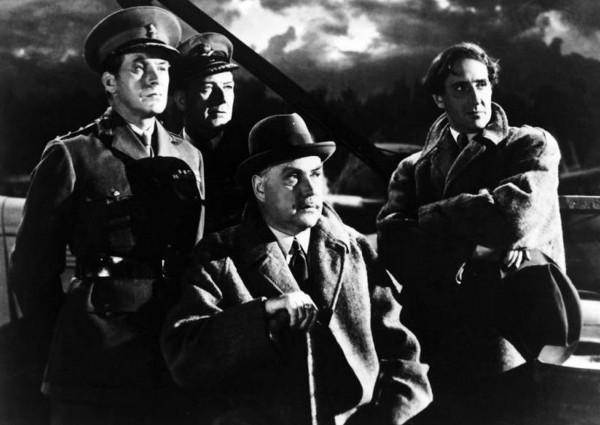 Non idetnifiés, Nigel Bruce (au centre), Basil Rathbone (à droite)