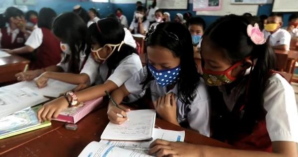 Enfants « masqués » à l'école