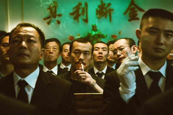 Liao Fan (au centre), personnages